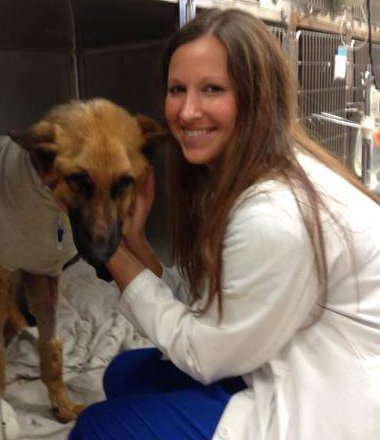 Dr. Erica Bello with a sick dog