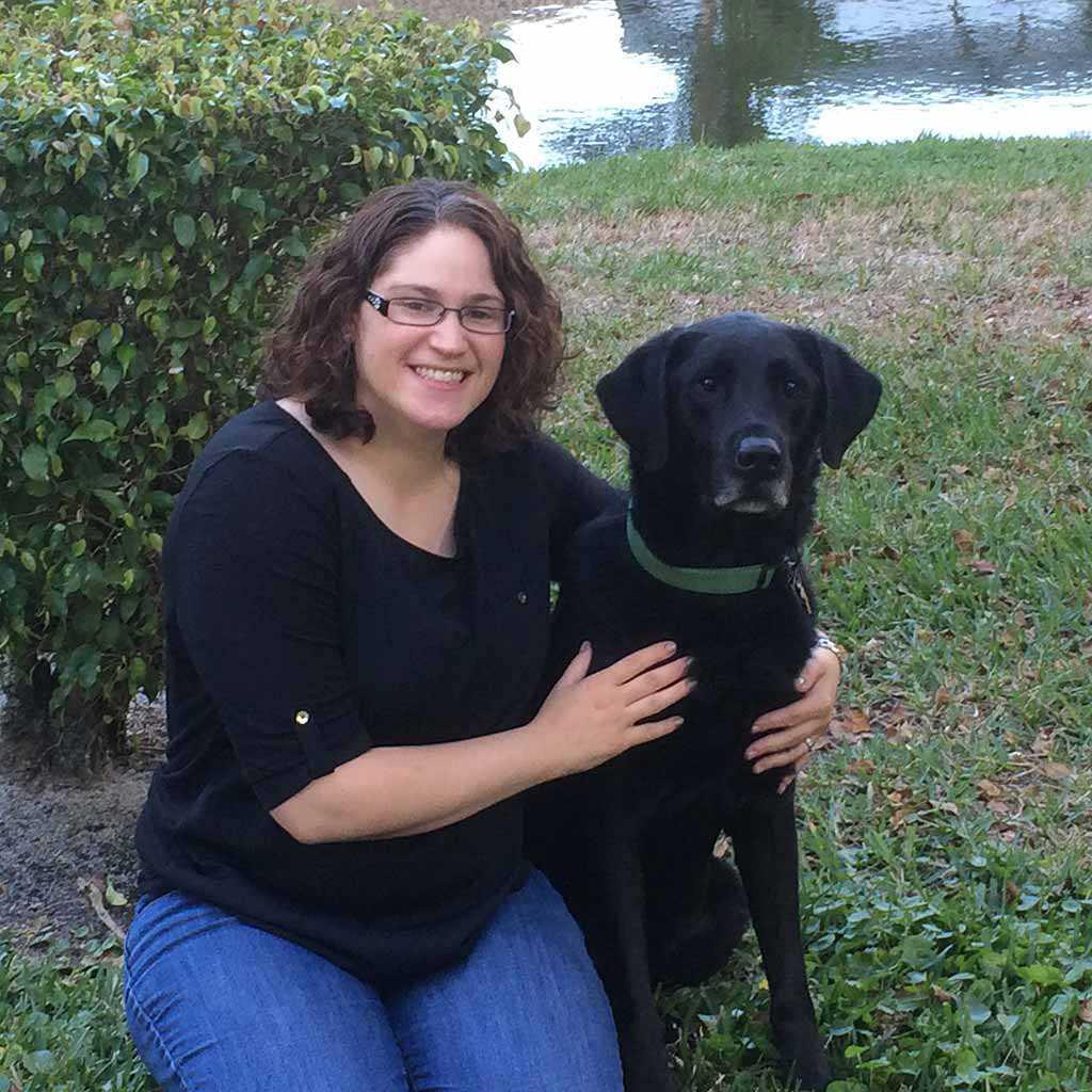 Dr. Stephanie Tessler, Veterinarian with a dog